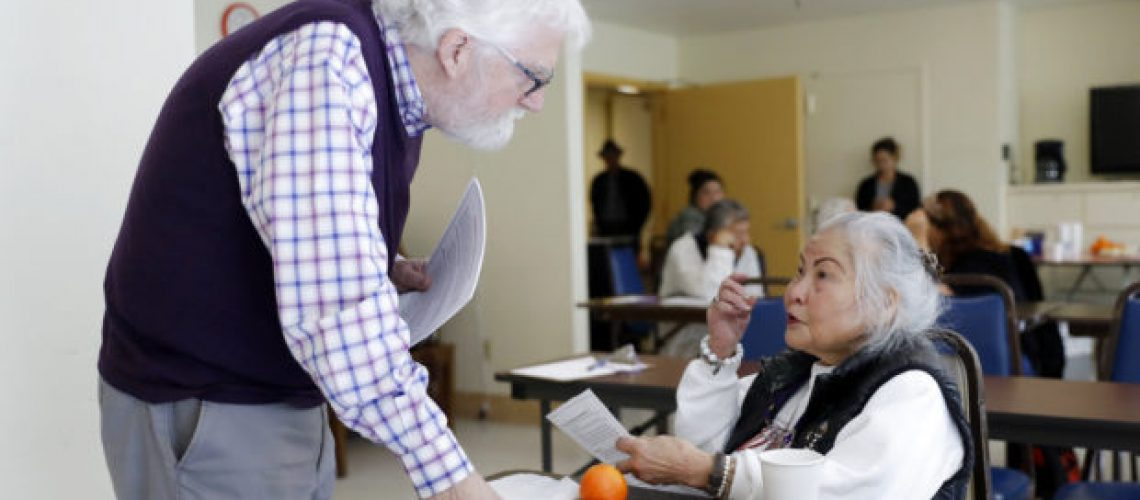 In this Friday, April 13, 2018 photo, Patrick Arbore, left, talks to Corazon Leano as he conducts an anti-bullying class at the On Lok 30th Street Senior Center in San Francisco. Nursing homes, senior centers and other places older adults gather are confronting a problem long thought the domain of the young: Bullying. (AP Photo/Marcio Jose Sanchez)